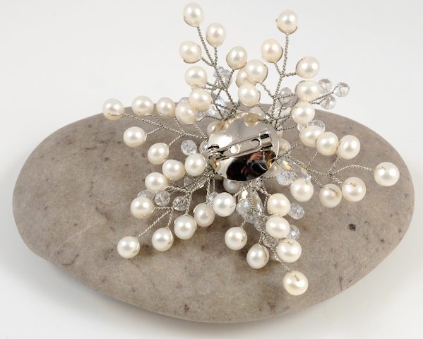 Back of white Snowflake Brooch